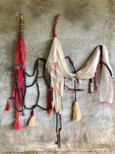 Maliza Kiasuwa paintings on recycled materials